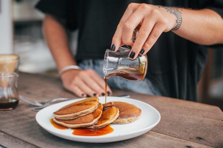 Banana homemade pancakes with maple syrup. Very tasty breakfast