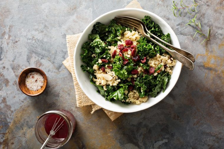 Healthy raw kale and quinoa salad with cranberry and almonds