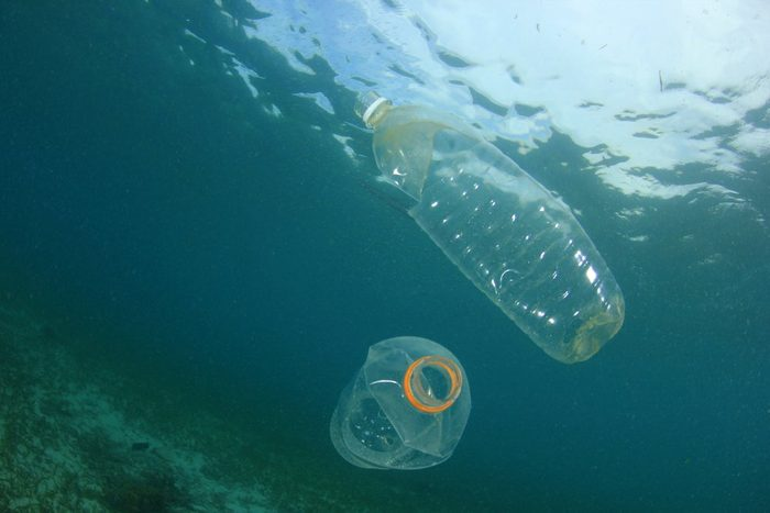 Plastic trash in ocean. Plastic bottles, bags, straws and cups underwater. Environmental pollution problem.