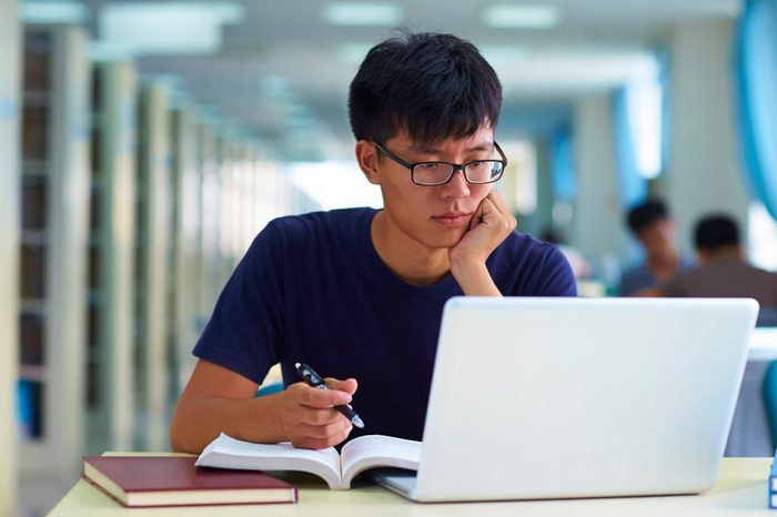 one college student study in the library with laptop