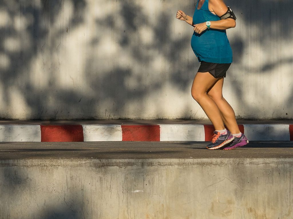 woman running pregnant
