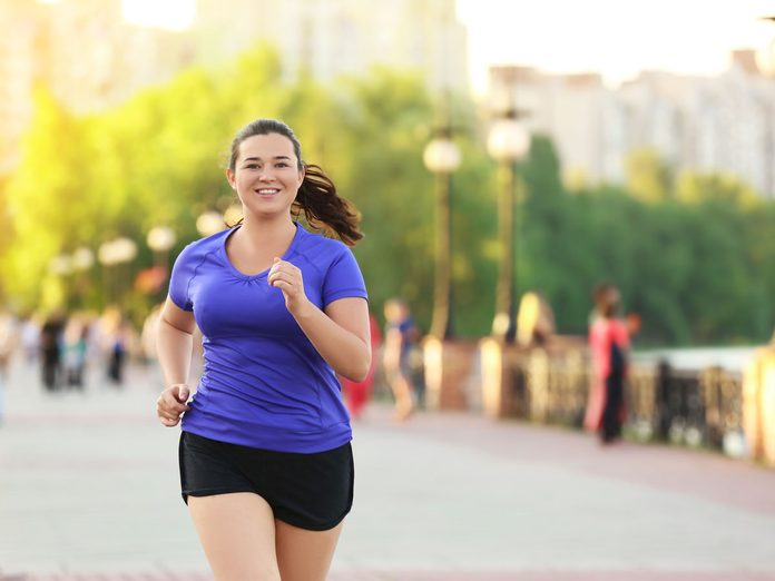 women running runner's high happy