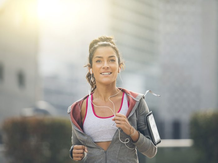 woman running music outside