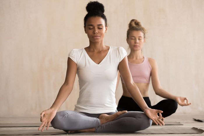 women meditate