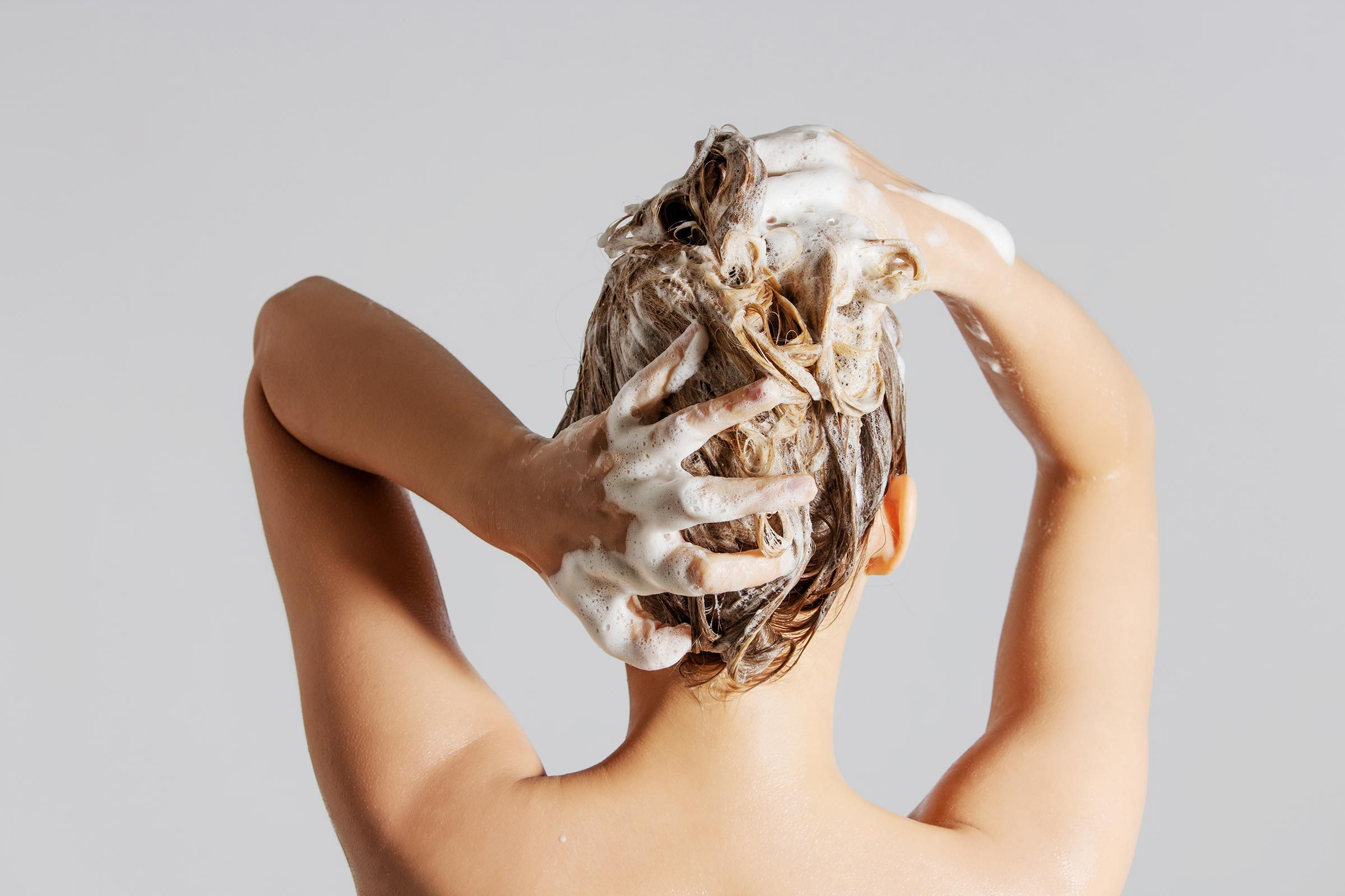 woman shampoo wash hair