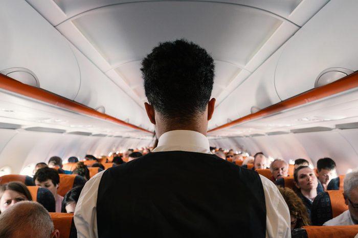 LONDON, UNITED KINGDOM - CIRCA MAY, 2018: Steward working inside Easy Jet airplane at Gatwick Airport.