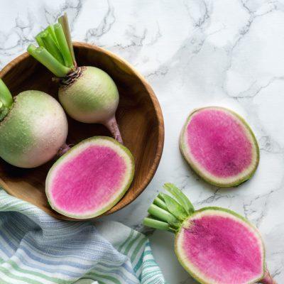 Watermelon red radish (chinese daikon) on marble table.