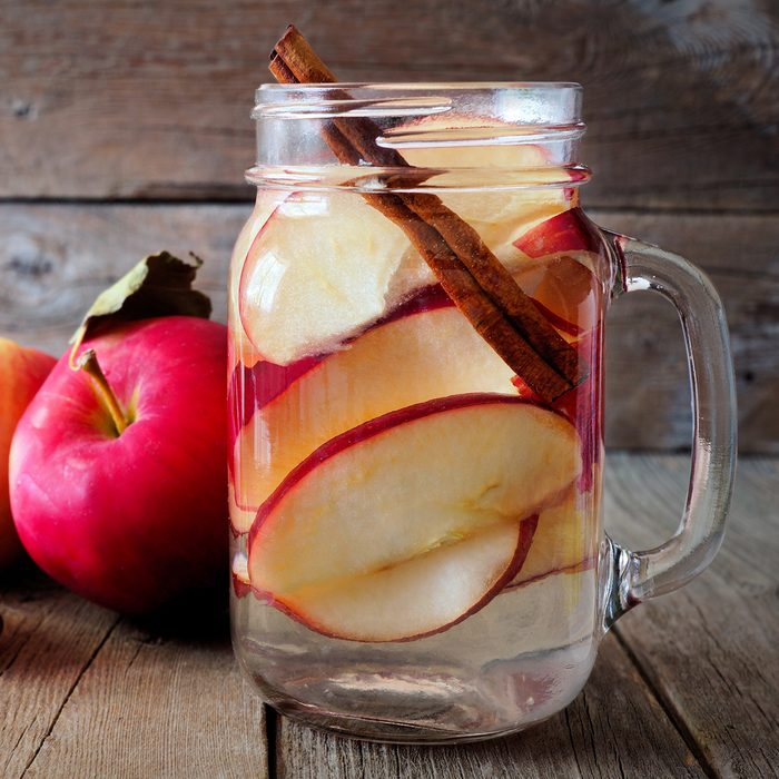 Autumn themed detox water with apple, cinnamon and red pear in a mason jar on a rustic wood background; Shutterstock ID 474961468; Job (TFH, TOH, RD, BNB, CWM, CM): Taste of Home