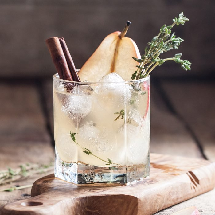 Cold pear white tea with thyme, cinnamon and honey on the olive desk and wooden background; Shutterstock ID 489772735; Job (TFH, TOH, RD, BNB, CWM, CM): Taste of Home