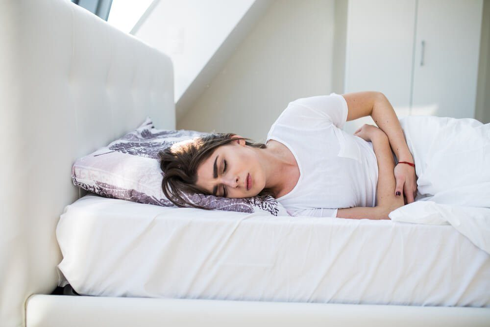 menstruation pain or stomach ache on bed