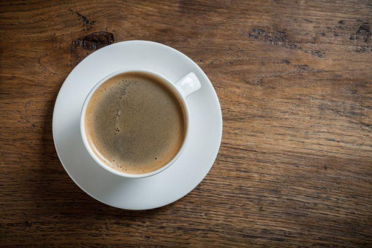 Coffee on vintage wood desk background