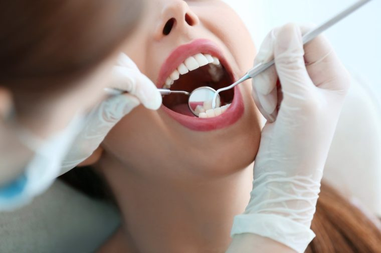 Dentist examining patient's teeth, close up