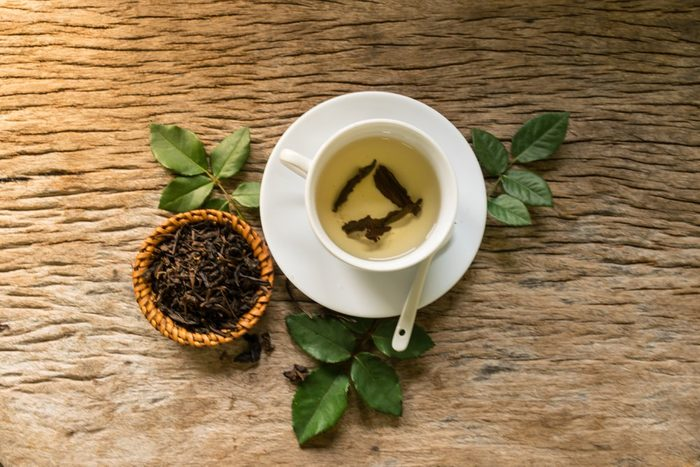 hot tea on wooden table, feeling warm heart in to love, moring fresh daily to working, feeling lovely concept. start to good working.