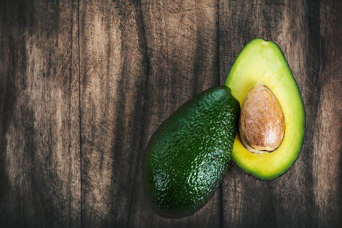 Food background with fresh organic avocado