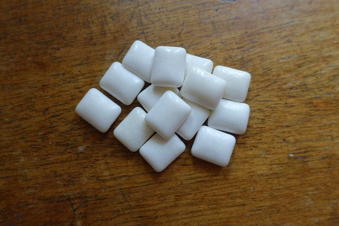 Chewing gum on wooden table from above