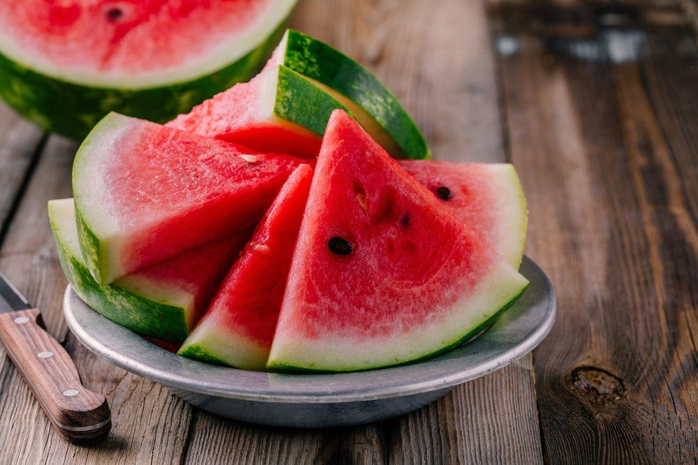 Fresh ripe sliced watermelon on wooden rustic background
