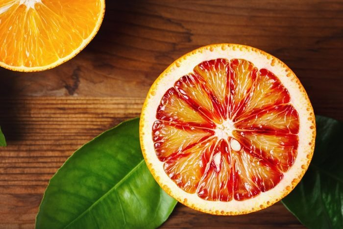 Blood orange fruit close up on wooden table. Top view.