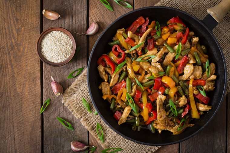 Stir fry chicken, sweet peppers and green beans. Top view