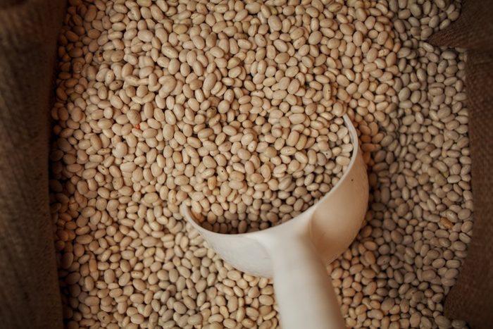 orange / red lentils. Legumes, pulses. Orange lentils full background, top view. Heap of red lentil (masoor dal) texture as background. Top view. some red lentils forming a background pattern
