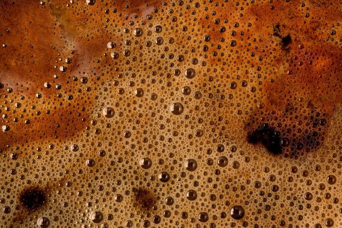 Coffee foam extreme close up. Macro texture and background