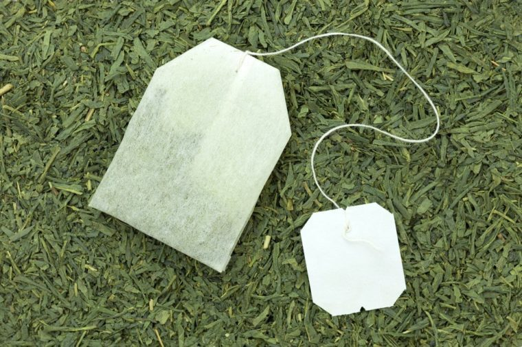green tea bag on tea leaves