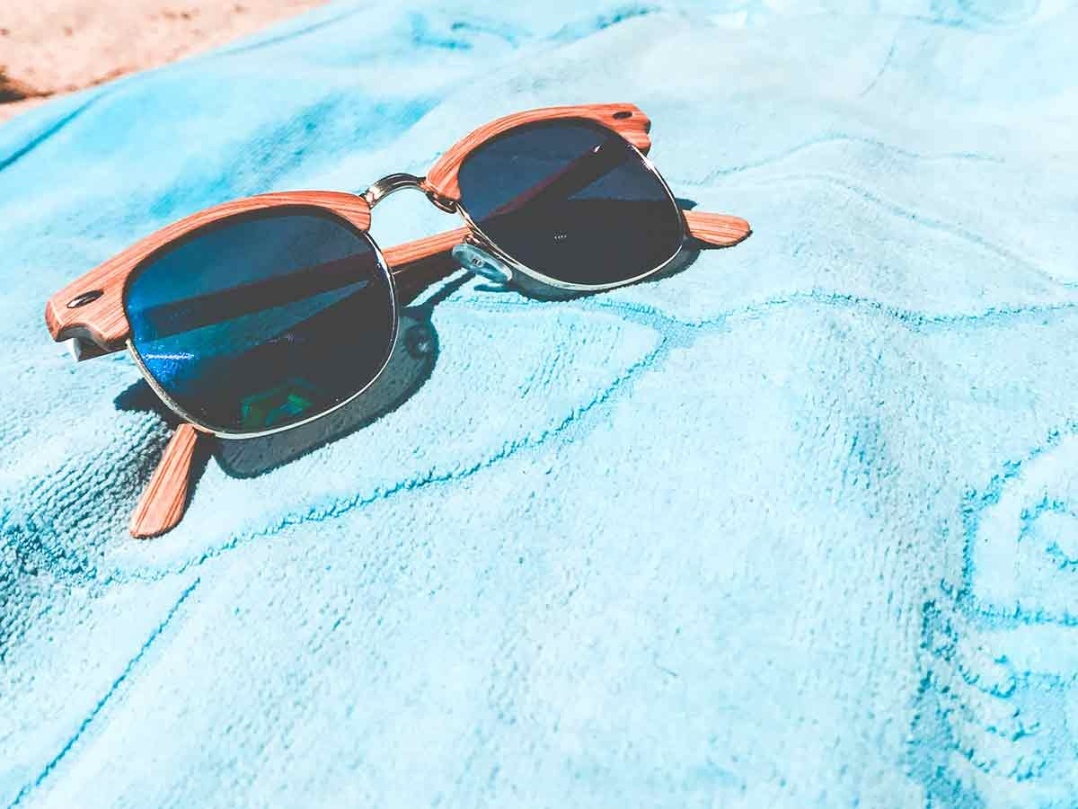 beach towel and sunglasses