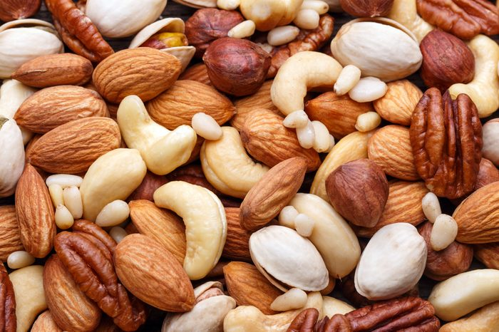 Mixed nuts background closeup. Natural organic food.