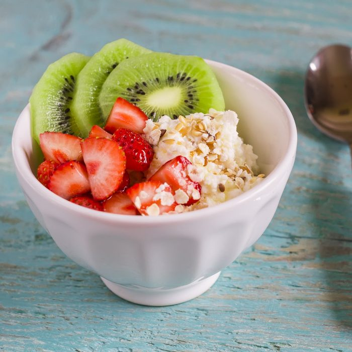 cottage cheese with strawberries, kiwi, honey, cereals and seeds of flax