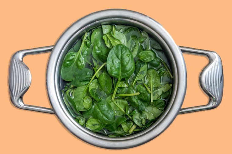 Washed fresh mini spinach. Top view.
