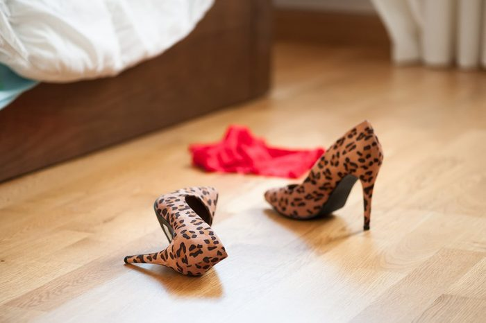 Heels of prostitute lying on the ground after a night of passion