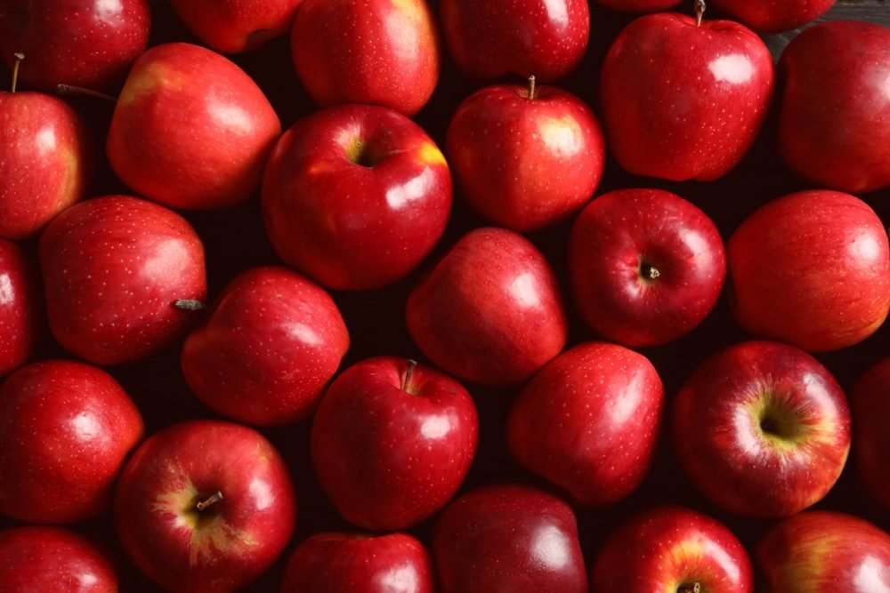 Fresh ripe red apples as background