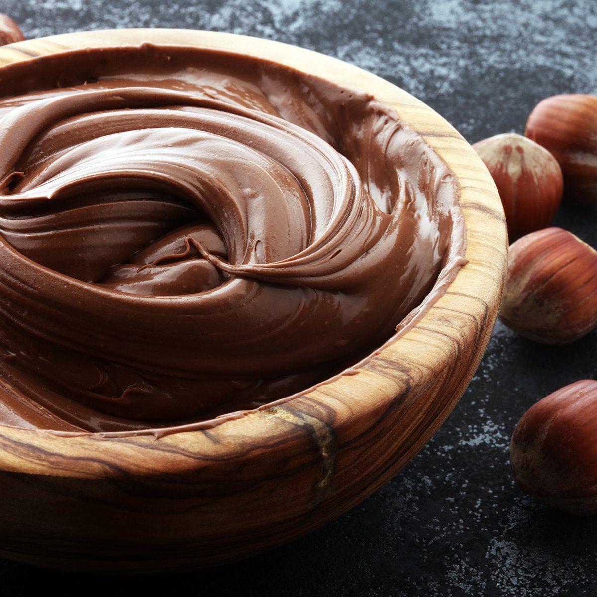 Homemade hazelnut spread in wooden bowl.