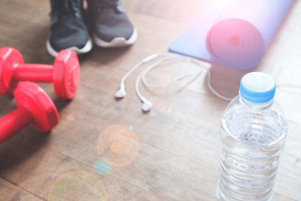dumbbells, running shoes, bottled water, ear buds