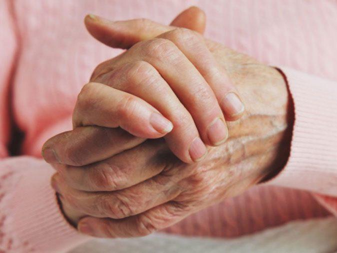 Ibuprofen - woman's hands