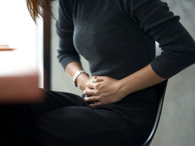 Ibuprofen - woman holding stomach