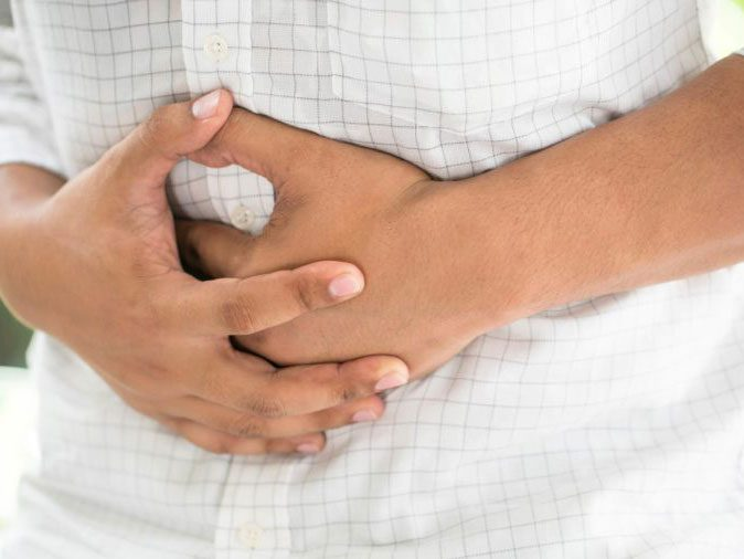 flu season - holding stomach
