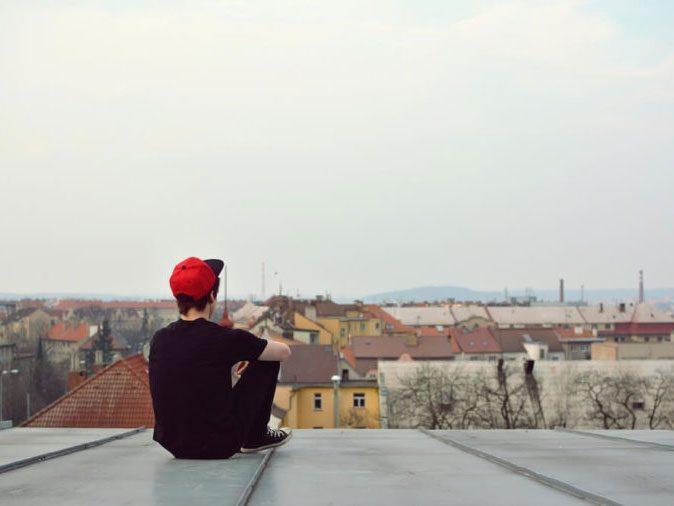 men domestic violence - man sitting on roof