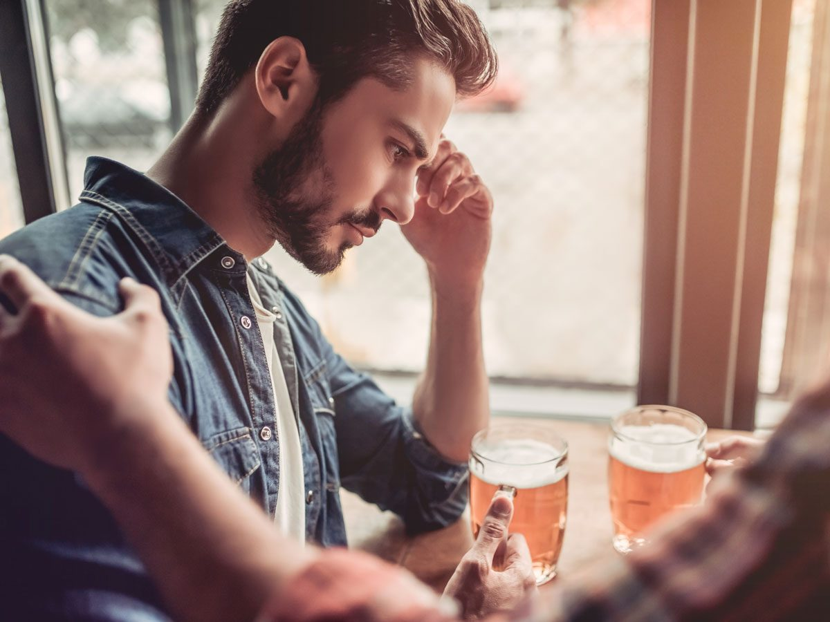 men domestic violence - man sitting