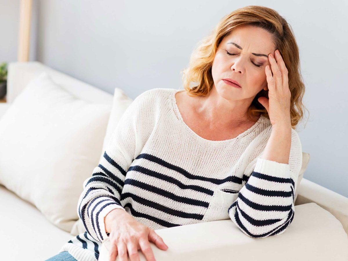 genetics - woman with migraine