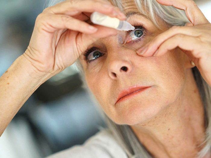 genetics - woman putting in eye drops