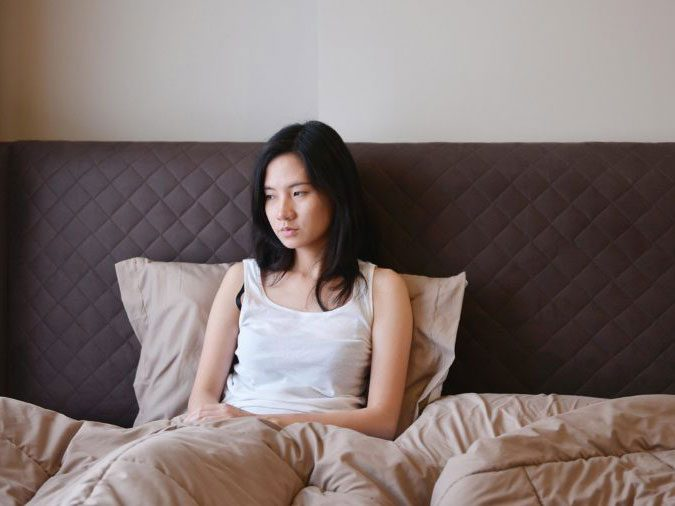 human body - woman tired in bed
