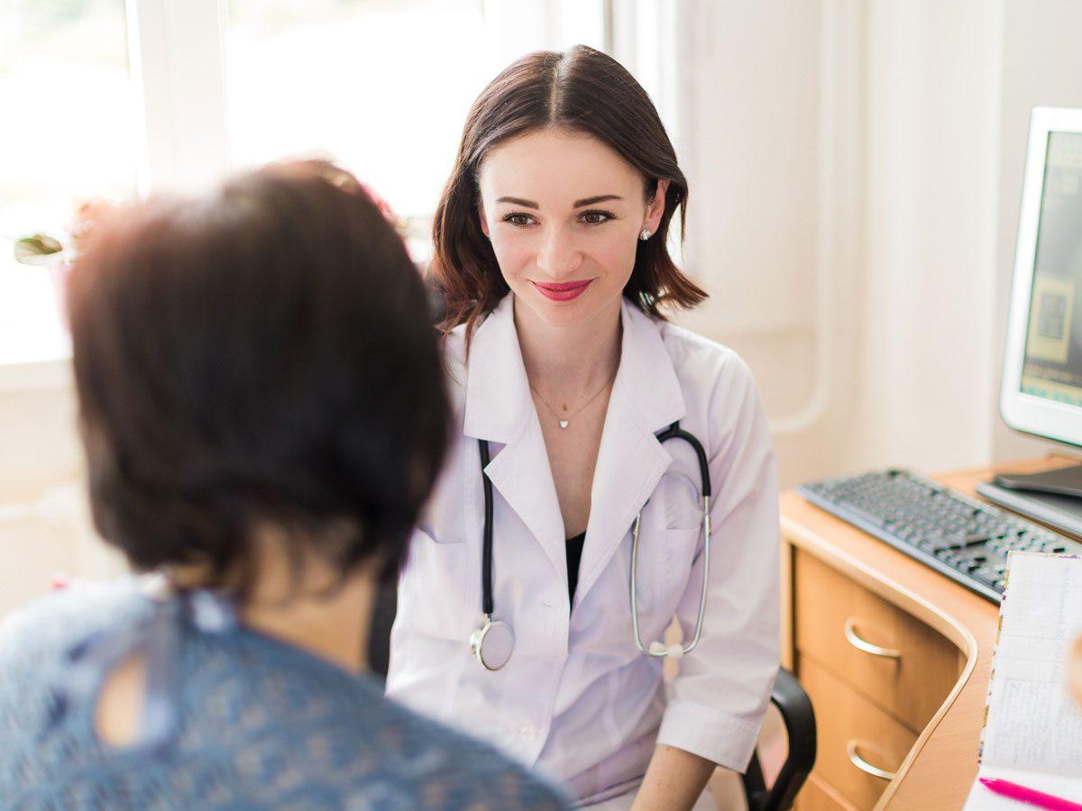 genetics - woman at the doctors
