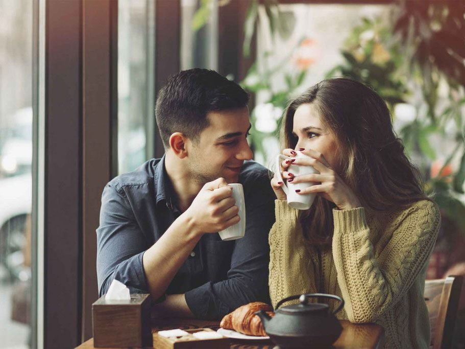 naturally charming people - couple at a cafe