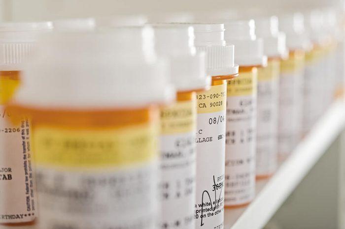 Bottles of pills arranged on shelf at drugstore
