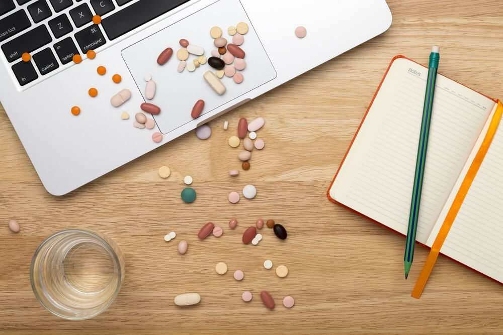 Close-up pills on computer keyboard, concept on line selling pills
