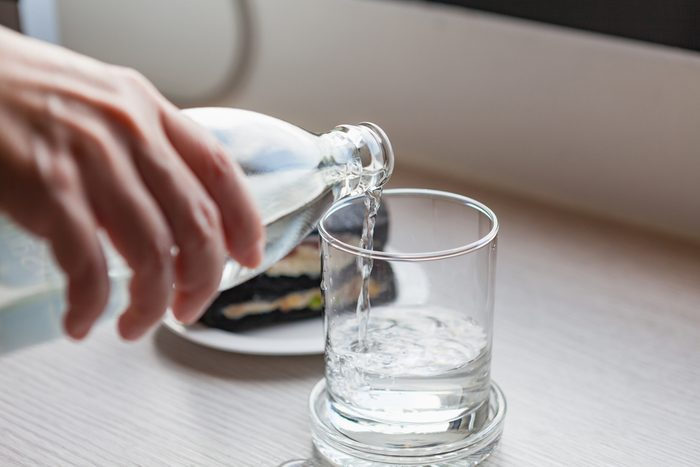 anti-aging advice | pouring water into glass