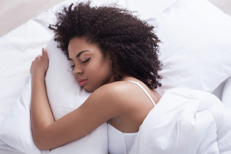 Beautiful young woman is napping in bedroom