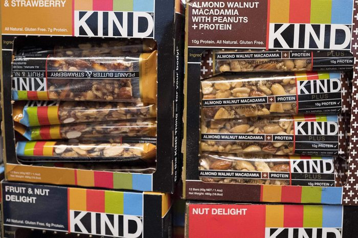 "Kind snack bars are displayed in a New York supermarket, . Kind CEO Daniel Lubetzky is pledging $25 million over the next 10 years to create a nonprofit dedicated to ""revealing and countering"" the food industry's influence on public health. The move underscores the division between ""Big Food"" companies and newer players that market themselves as wholesome alternatives aligned with public health"