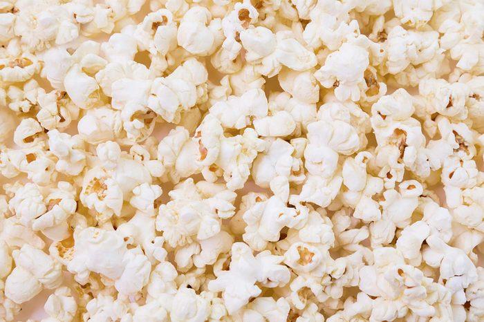 Bowl of popcorn isolated on white background