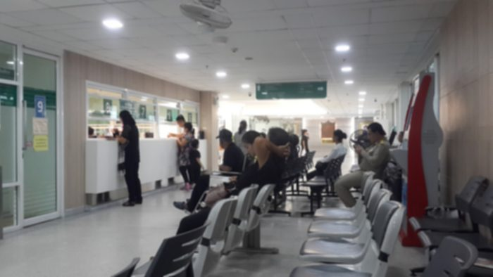 crowded pharmacy with long lines